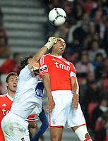 20120331: LISBON, PORTUGAL – Portuguese Liga Zon Sagres 2011/2012 - SL Benfica vs CS Braga.<br />In picture: Benfica's defense Luisao, from Brazil, right, heads the ball with Braga's Quim.<br />PHOTO: Alvaro Isidoro/CITYFILES