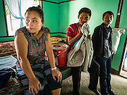 26 OCTOBER 2016 - MYAWADDY, KAYIN STATE, MYANMAR: A family of Burmese refugees repatriated to Myanmar from Nupo Temporary Shelter refugee camp in Thailand look at their new housing in a displaced persons facility for returning refugees in Myawaddy, Myanmar. Sixtyfive Burmese refugees living in the Nupo Temporary Shelter refugee camp in Tak Province of Thailand were voluntarily repatriated to Myanmar. About 11,000 people live in the camp. The repatriation was the first large scale repatriation of Myanmar refugees living in Thailand. Government officials on both sides of the Thai / Myanmar border said the repatriation was made possible by recent democratic reforms in Myanmar. There are approximately 150,000 Burmese refugees living in camps along the Thai / Myanmar border. The Thai government has expressed interest several times in the last two years in starting the process of repatriating the refugees.     PHOTO BY JACK KURTZ