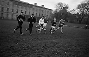 The Welsh Rugby Team to meet Ireland in the postponed international at Lansdowne Road practice on the eve of the match at Trinity College, Dublin..1962. .16.11.1962..11.16.1962..16th November 1962...Image shows the Welsh Rugby team practicing on the pitch at Trinity College, Dublin..Picture shows the Welsh captain, Meredith, recieving a pass from John Davis..16.11.1962
