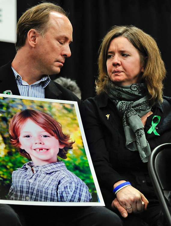 Mark and Jackie Barden, parents of Sandy Hook shooting victim Daniel Barden, hold hands at news conference at Edmond Town Hall in Newtown, Conn., Monday, Jan. 14, 2013. One month after the mass school shooting at Sandy Hook Elementary School, the parents joined a grassroots initiative called Sandy Hook Promise to support solutions for a safer community. (AP Photo/Jessica Hill)