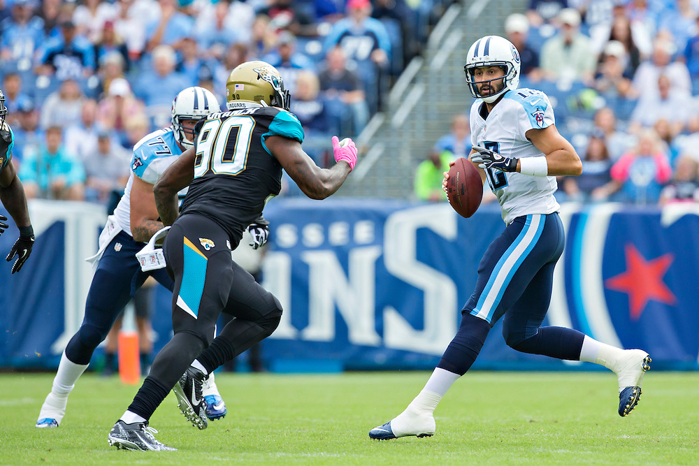 NASHVILLE, TN - OCTOBER 12:  Charlie Whitehurst #12 of the Tennessee Titans drops back to pass under pressure from Andre Branch #90 of the Jacksonville Jaguars at LP Field on October 12, 2014 in Nashville, Tennessee.  The Titans defeated the Jaguars 16-14.  (Photo by Wesley Hitt/Getty Images) *** Local Caption *** Charlie Whitehurst; Andre Branch