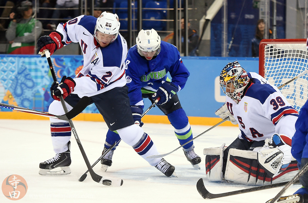 Feb 16, 2014; Sochi, RUSSIA; USA goalie Ryan Miller (39) and defenseman Ryan Suter (20) defend the net against Slovenia forward Ziga Jeglic (8) in a men's ice hockey preliminary round game during the Sochi 2014 Olympic Winter Games at Shayba Arena.