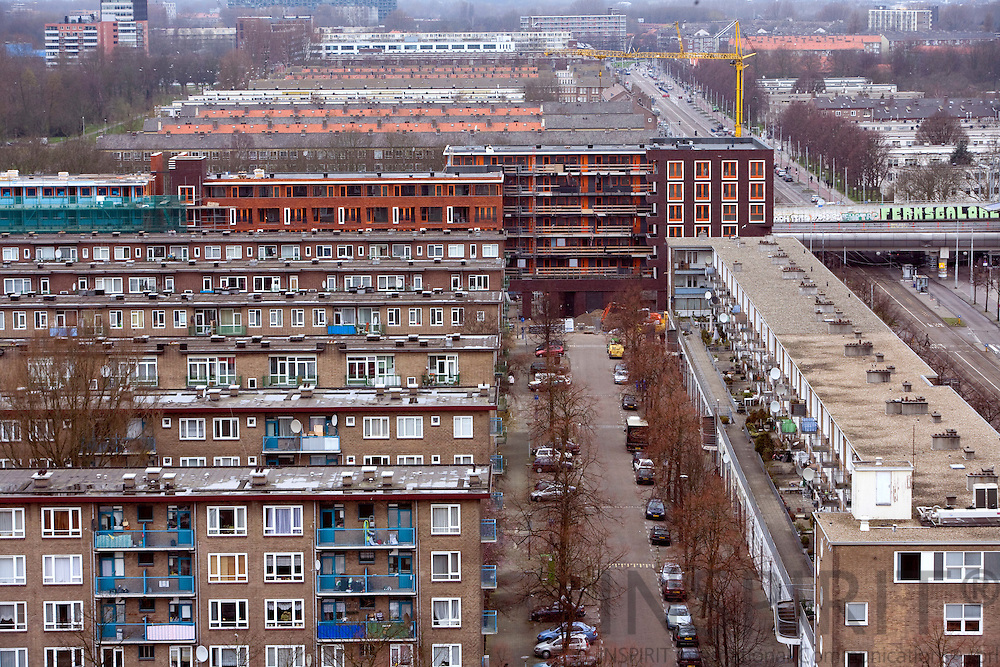 AMSTERDAM - NETHERLANDS - 06 MARCH 2008 -- New buildings under construction in the back while the apartment blocks in the front from the 1950 will later be replaced with new.  Photo: Erik Luntang