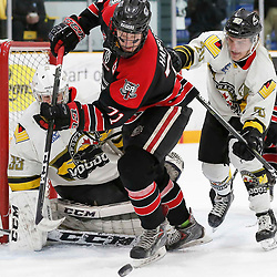 TRENTON, ON  - MAY 5,  2017: Canadian Junior Hockey League, Central Canadian Jr. &quot;A&quot; Championship. The Dudley Hewitt Cup. Game 7 between The Georgetown Raiders and The Powassan Voodoos. Jonathan Hampton #71 of the Georgetown Raiders and Dayton Murray #20 of the Powassan Voodoos battle for the puck during the second period <br /> (Photo by Amy Deroche / OJHL Images)