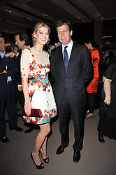 ROSAMUND PIKE and PADDY BYNG Managing Director of Asprey at the BAFTA Nominees party 2011 held at Asprey, 167 New Bond Street, London on 12th February 2011.