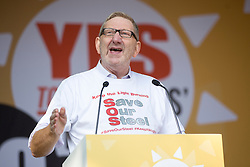 © Licensed to London News Pictures. 04/10/2015. Manchester, UK. Picture shows Len McCluskey at the Anti Austerity protest in Manchester expected to attract thousands of people to protest against Austerity cuts at the start of the Conservative Party Conference in the city. Photo credit: Andrew McCaren/LNP