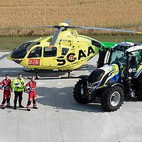 SCAA…Scotland's Charity Air Ambulance 'Helimed 76' pictured with Police Scotland's tractor ahead of the Perth Show on the 4/5th August…The tractor has been loaned to Police Scotland Specialist Crime Division who are responsible for rural and agricultural crimes, pictured from left paramedic Darren O'Brien, PC Frank Donald Police Scotland Roads Policing Unit and paramedic Rich Garside<br />