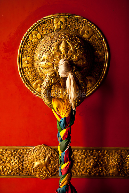 Detail of a Buddhist temple door at Swayambunath, one of the oldest and most holy religious sites in Kathmandu.