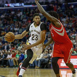 Mar 17, 2017; New Orleans, LA, USA; New Orleans Pelicans forward Anthony Davis (23) drives past Houston Rockets forward Montrezl Harrell (5) during the second half of a game at the Smoothie King Center. The Pelicans defeated the Rockets 128-112.  Mandatory Credit: Derick E. Hingle-USA TODAY Sports