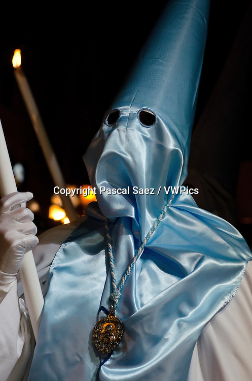 Thursday 28 March 2013 - Santander, Spain - Holy Thursday procession underway in Santander (part of Semana Santa, or Holy Week). Hooded penitents walk through the city centre carrying floats with effigies of Jesus Christ or the Virgin Mary, to the music of marching bands.