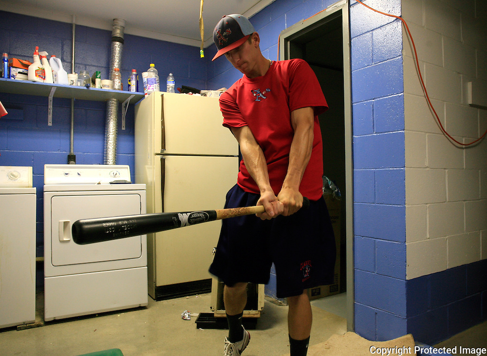 A's center fielder Seve Alvarez works on his swing in the locker room prior to a game with the Omaha Diamond Spirit.  Alvarez's father, Jose, played in Clarinda in 1978, and later in the major leagues as a pitcher.  photo by David Peterson