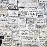 Burial markers on a wall in the knave of Iglesia de San Francisco in Antigua, Guatemala.