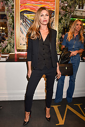 Abbey Clancy at a private view of work by Bradley Theodore entitled 'The Second Coming' at the Maddox Gallery, 9 Maddox Street, London England. 19 April 2017.