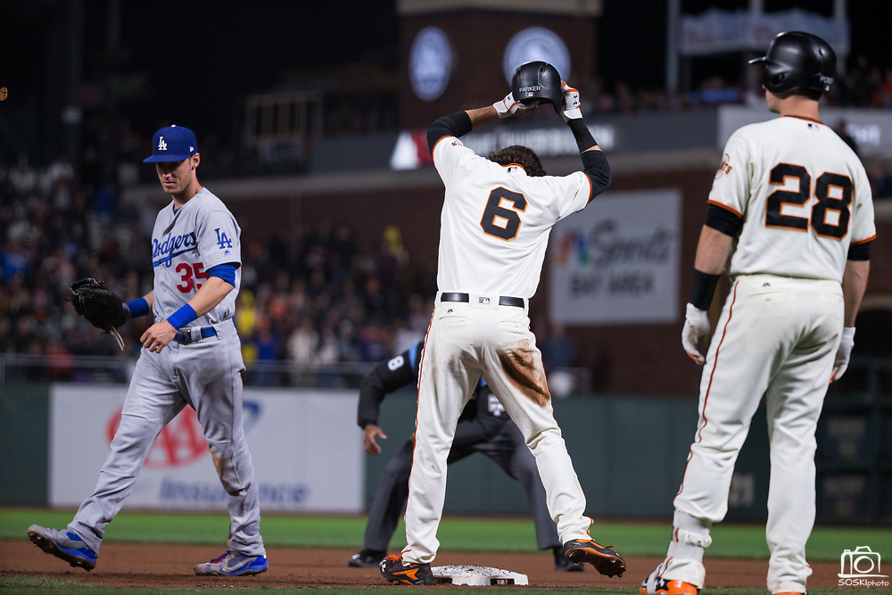 San Francisco Giants left fielder Jarrett Parker (6) nearly throws his helmet after being tagged out at first base by the Los Angeles Dodgers at AT&T Park in San Francisco, California, on September 13, 2017. (Stan Olszewski/Special to S.F. Examiner)