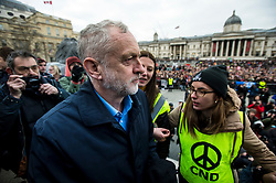 © Licensed to London News Pictures. 26/02/2016. London, UK. Leader of the labour party JEREMY CORBYN arrives on stage at Trafalgar Square at a CND (Campaign for Nuclear Disarmament) rally in central London on February 27, 2016. Corbyn has been criticised for publicly supporting the CND campaign while Labour Party policy  backs the renewal of Trident nuclear programme. Photo credit: Ben Cawthra/LNP