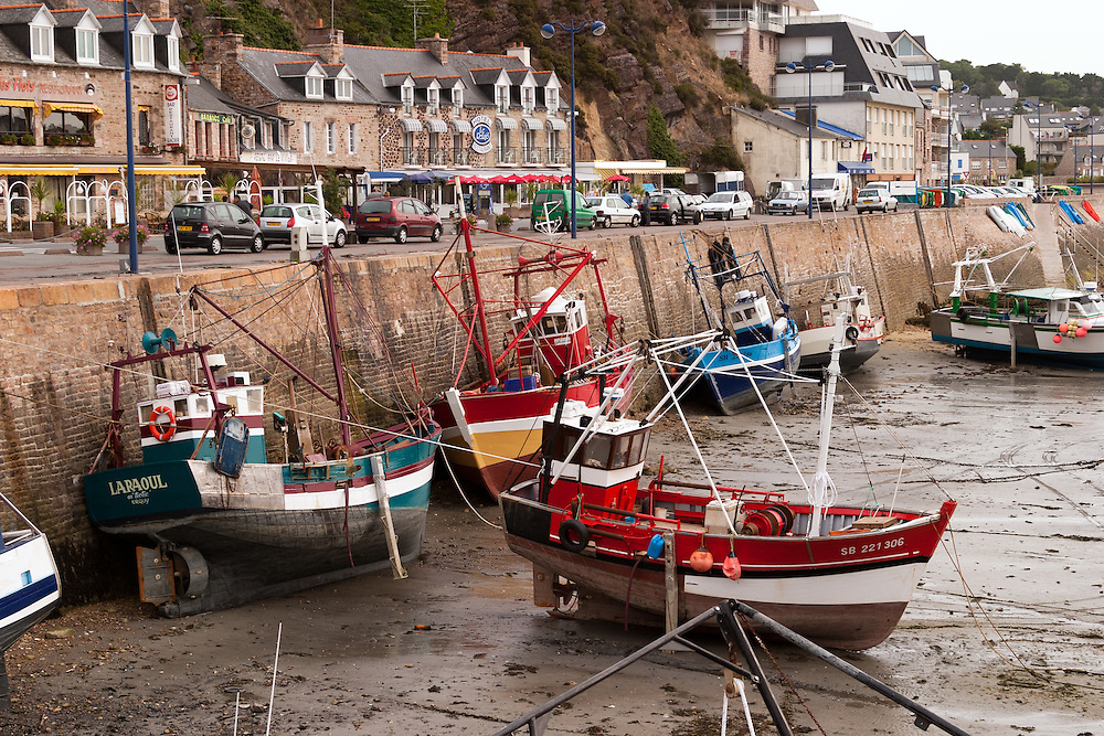 The picturesque little town of Erquy in the Brittany region of France offers a colorful harbor, particularly when the tide goes out.