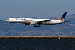 Boeing 777-322(ER) (N2341U) operated by United Airlines landing at San Francisco International Airport (KSFO), San Francisco, California, United States of America