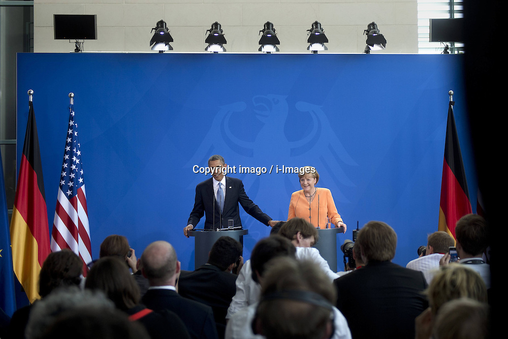 59860285  <br /> Barack Obama, president of the USA, and German Chancellor Angela Merkel (right) during a press call at a state visit of the Chancellery in Berlin, Germany. Barack Obama will walk in John F. Kennedy's footsteps this week on his first visit to Berlin as US president, but encounter a more powerful and sceptical Germany in talks on trade and secret surveillance practices. International Politics, Berlin, Germany on Wednesday 19 June, 2013. UK ONLY