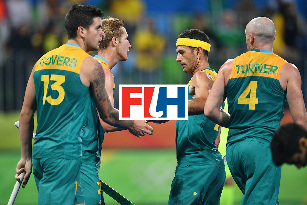 Australia's players celebrate during the mens's field hockey Australia vs Brazil match of the Rio 2016 Olympics Games at the Olympic Hockey Centre in Rio de Janeiro on August, 12 2016. / AFP / Carl DE SOUZA        (Photo credit should read CARL DE SOUZA/AFP/Getty Images)