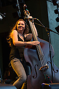 Lucia Turino of The Devil Makes Three on stage at Celebrate Brooklyn. Turino appears to dance with her bass.
