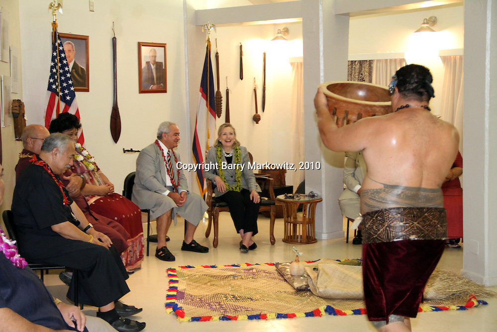 US Secretary of State Hillary Clinton is delighted by the gift of a large traditional kava bowl as Governor Togiola Tulafono explains the cultural significance.  Kahuku High School graduate, US Congressman Faleomavaega Hunkin looks on from the side.  Photo by Barry Markowitz, 11/8/10, 12:30am