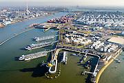 Nederland, Zuid-Holland, Rotterdam, 18-02-2015. Botlek, Geulhaven met Verkeerscentrale Rotterdam. Binnenvaarttankers liggen voor anker. Rechts LBC tank terminals en Odfjell, links Shell raffinaderije..<br /> Main harbor traffic station, moored inland tankers and oil terminals.<br /> luchtfoto (toeslag op standard tarieven);<br /> aerial photo (additional fee required);<br /> copyright foto/photo Siebe Swart