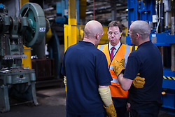 © Licensed to London News Pictures . 04/07/2014 . Sheffield , UK . The Deputy Prime Minister , NICK CLEGG MP , talking to men next to machines at Chapmans Agricultural Parts on Friday 4th July 2014 as this morning (Monday 7th June 2014) Nick Clegg launches the British Government's local Growth Deals . The Government says that £12 billion will be invested in local business , training and infrastructure projects .  Photo credit : Joel Goodman/LNP .  Photo credit : Joel Goodman/LNP