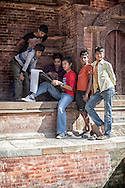 Nepali boys gather round a sketch artist.