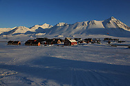 International science village of Ny-Alesund sits amid April snows on Spitsbergen island in Kongsfjorden; Svalbard, Norway.
