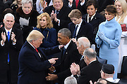 President Donald Trump shakes hands with outgoing President Barack Obama after taking the oath of office as the 45th President during the Inaugural Ceremony on Capitol Hill January 20, 2017 in Washington, DC.