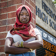 WOODBRIDGE,VA-JUN8: Hajah Bah, outside Freedom High School, in Woodbridge, Virginia, June 8, 2017. Hajah began wearing a hijab last week for Ramadan, leading to a confrontation with an administrator who threatened to write her up when she refused to remove it and protested. School administrators have since apologized to both young women and their families. (Photo by Evelyn Hockstein/For The Washington Post)