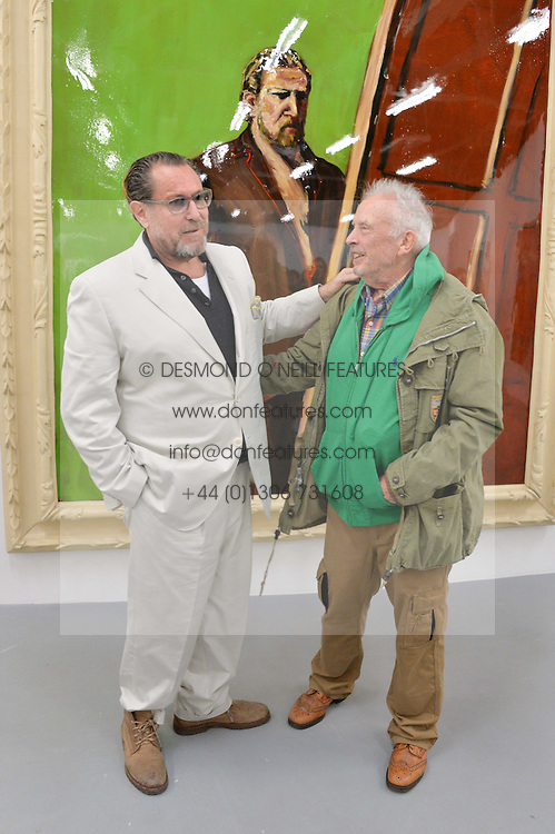 Left to right, JULIAN SCHNABEL and DAVID BAILEY at a private view in aid of Chickenshed of Julian Schnabel's first UK solo show of paintings for 15 years entitled 'Every Angel Has A Dark Side' held at the Dairy Art Centre, 7a Wakefield Street, Bloomsbury, London on 24th April 2014.