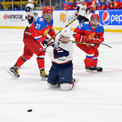 WHITBY, - Dec 17, 2015 -  Game #10 - United States vs. Russia at the 2015 World Junior A Challenge at the Iroquois Park Recreation Complex, ON.  Callahan Burke #11 of Team United States gets tangled with Ivan Kosorenkov #37 of Team Russia while skating after the puck during the second period.<br /> (Photo: Shawn Muir / OJHL Images)