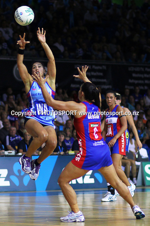 Steel's Liana Leota catches a pass over Mystics' Temepara George. LG Northern Mystics v Southern Steel. ANZ Netball Championship. Trusts Stadium, Auckland, New Zealand. Monday 14th February 2011. Photo: Anthony Au-Yeung / photosport.co.nz