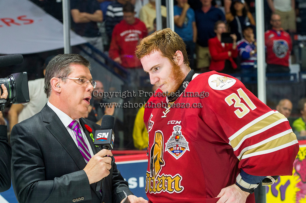 REGINA, SK - MAY 27: Sportsnet game host Rob Faulds speaks to Evan Fitzpatrick #31 of Acadie-Bathurst Titan on they ice after the win against the Regina Pats at the Brandt Centre on May 27, 2018 in Regina, Canada. (Photo by Marissa Baecker/CHL Images)
