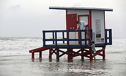 Children play in the lifeguard tower engulfed with waves brought by hurricane Dorian at the Cocoa Beach Pier, on Tuesday, September 3, 2019.Photo by Ricardo Ramirez Buxeda/ Orlando Sentinel/TNS/ABACAPRESS.COM