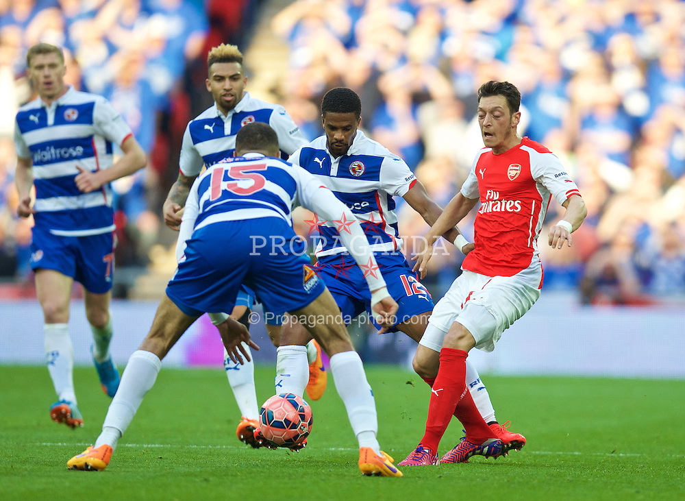 LONDON, ENGLAND - Saturday, April 18, 2015: Reading's Gareth McCleary stands on the heel of Arsenal's Mesut Ozil during the FA Cup Semi-Final match at Wembley Stadium. (Pic by David Rawcliffe/Propaganda)
