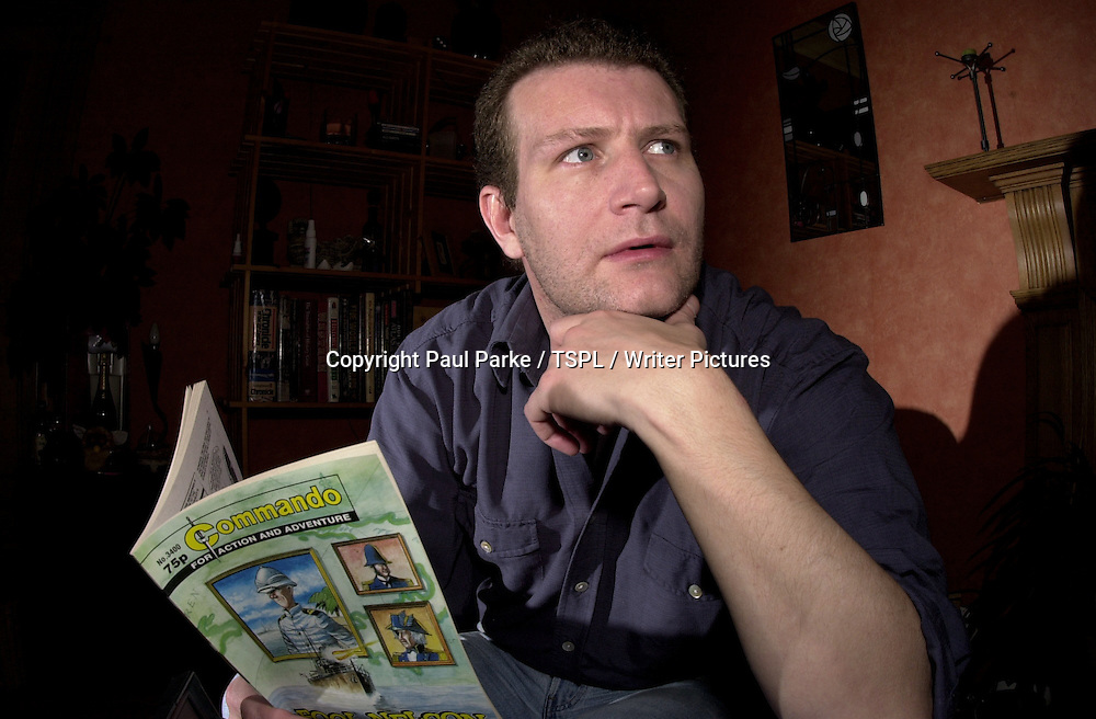 Ferg Handley, &lsquo;Commando&rsquo; comic book designer, photographed in his Edinburgh flat and place of work, September 13, 2001. <br /> <br /> Copyright Paul Parke / TSPL / Writer Pictures<br /> Contact +44 (0)20 822 41564<br /> info@writerpictures.com<br /> www.writerpictures.com