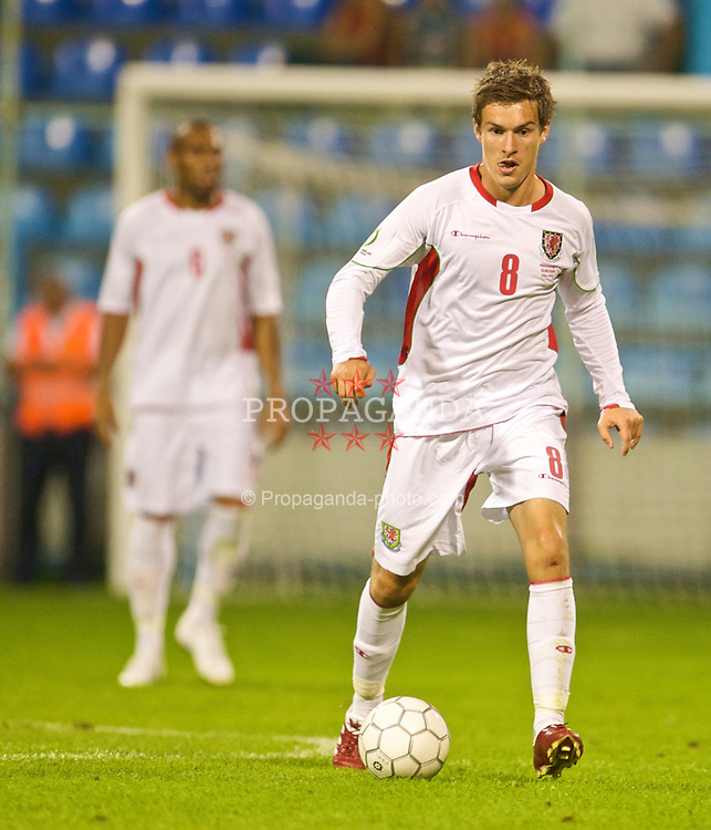 PODGORICA, MONTENEGRO - Wednesday, August 12, 2009: Wales' Aaron Ramsey in action against Montenegro during an international friendly match at the Gradski Stadion. (Photo by David Rawcliffe/Propaganda)