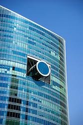 Unusual architectural design of glass office tower in Dubai United Arab Emirates