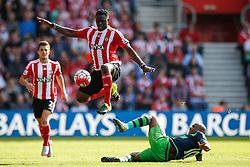 Southampton's Victor Wanyama jumps over Swansea City's Andre Ayew tackle - Mandatory by-line: Jason Brown/JMP - 07966 386802 - 26/09/2015 - FOOTBALL - Southampton, St Mary's Stadium - Southampton v Swansea City - Barclays Premier League