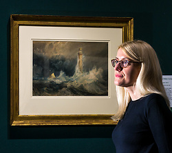 Pictured: Turner art exhibitionCurator Charlotte Topsfield admires the Bell Rock lighthouse painting by Turner. For more than a century the National Galleries of Scotland (NGS) have displayed an outstanding collection of Turner watercolours, from the 38 paintings bequeathed by Henry Vaughan in 1900. His will stipulated that the paintings should only be shown in January when daylight in Edinburgh is weak. The annual exhibition by artist Joseph Mallord William Turner (1775-1851) is supported by players of People's Postcode Lottery for the 7th year running. The focal point is a dramatic portrait of the Bell Rock lighthouse built by Robert Stevenson (1772-1850) which was commissioned 200 years ago by the lighthouse engineer to illustrate his book 'Account of the Building of Bell Rock Lighthouse'. Bell Rock is the oldest surviving rock lighthouse in the British Isles, first lit in 1811. It stands on a partially submerged reef near Angus, regarded by sailors as among the most dangerous places on the east coast of Scotland. The exhibition opens on New Year's Day at Scottish National Gallery and last for one month. 20 December 2018  <br /> <br /> Sally Anderson | EdinburghElitemedia.co.uk