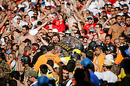 Stewards and police wade into the fans during the 2014 FIFA World Cup match at Mineir&atilde;o, Belo Horizonte, Brazil. <br /> Picture by Andrew Tobin/Focus Images Ltd +44 7710 761829<br /> 24/06/2014