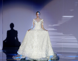 A model presents wedding dress designed by Wei Qiying during a fashion show of Jusere Wedding Dress Collection at China Fashion Week in Beijing, capital of China, March 30, 2016. EXPA Pictures © 2016, PhotoCredit: EXPA/ Photoshot/ Chen Jianli<br /> <br /> *****ATTENTION - for AUT, SLO, CRO, SRB, BIH, MAZ, SUI only*****