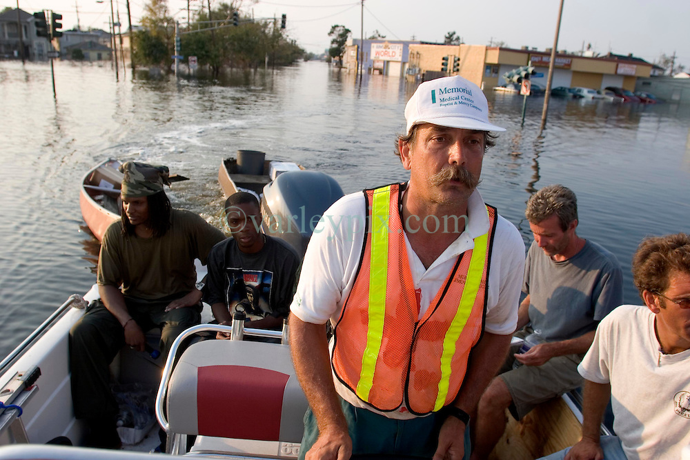 05 Sept  2005. New Orleans, Louisiana. Post hurricane Katrina.<br /> Animal rescue boat. Jimmy Delery, captain of a private rescue boat works all hours to save people and animals  from the devastating floods in Uptown New Orleans.<br /> Photo; &copy;Charlie Varley/varleypix.com