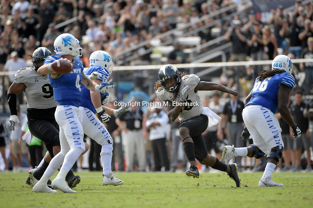 Central Florida linebacker Shaquem Griffin (18) pursues Memphis quarterback Riley Ferguson (4) as he sets up to throw a pass during the first half of the American Athletic Conference championship NCAA college football game Saturday, Dec. 2, 2017, in Orlando, Fla. (Photo by Phelan M. Ebenhack)