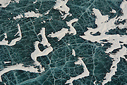 Aerial view of frozen lake ice Kluane National Park and Reserve of Canada near Haines Junction in the Yukon.