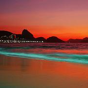 Sunrise at Rio de Janeiro's Copacabana beach, Copacabana with Sugar Loaf mountain in the distance. Rio de Janeiro, Brazil. 11th December 2011. Photo Tim Clayton..