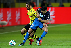 DORTMUND, Dec. 17, 2017  Nadiem Amiri (R) of Hoffenheim and Jeremy Toljan of Dortmund battle for the ball during the Bundesliga match between Borussia Dortmund and TSG 1899 Hoffenheim at Signal Iduna Park on December 16, 2017 in Dortmund, Germany. Dortmund won 2-1. (Credit Image: © Joachim Bywaletz/Xinhua via ZUMA Wire)
