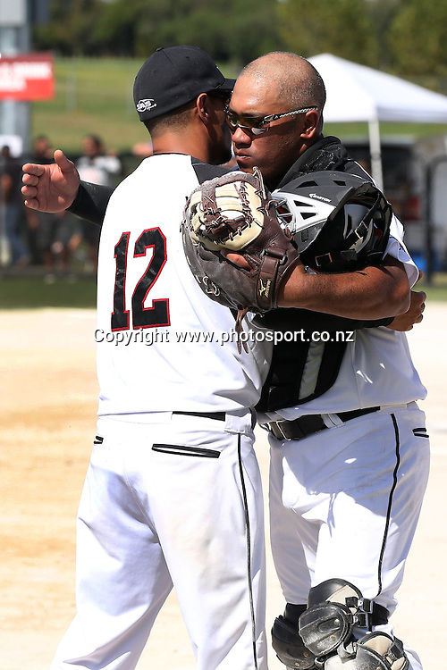 Nathan Nukunuku (left) of the Black Sox and Stephen Ratu of the Black Sox during game two of the Trans Tasman Softball Series between the New Zealand Black Sox and the Australian Steelers at Tradestaff Rosedale Park in Albany, Auckland on 29 March 2014. Photo: Jason Oxenham / www.photosport.co.nz